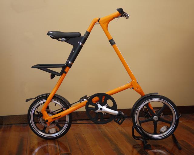 Strida bike stand and a Strida sunkist orange LT
